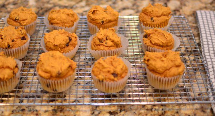 A dozen pumpkin spice muffins on a cooling rack