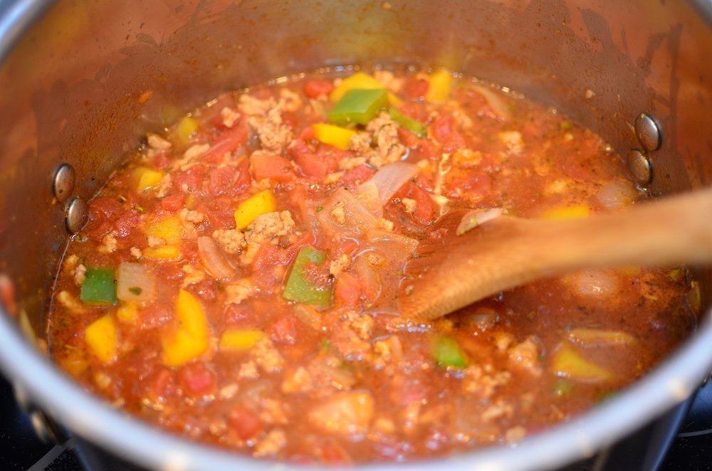 Simmer chili on the stove