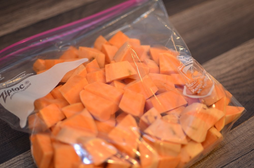 cubed sweet potatoes in a large ziploc bag