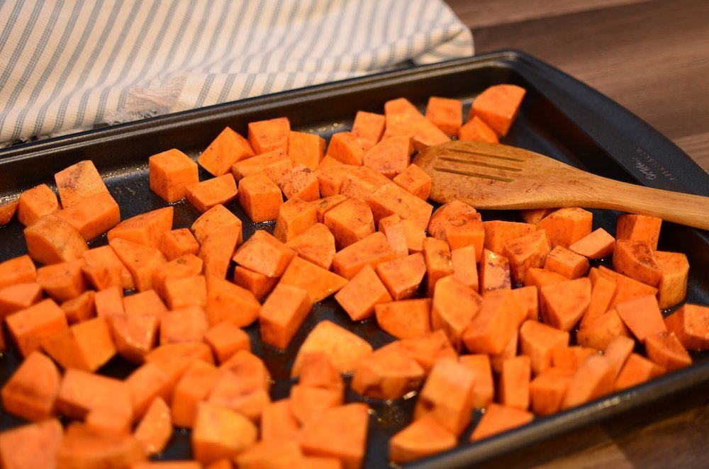 honey cinnamon sweet potatoes on a baking sheet
