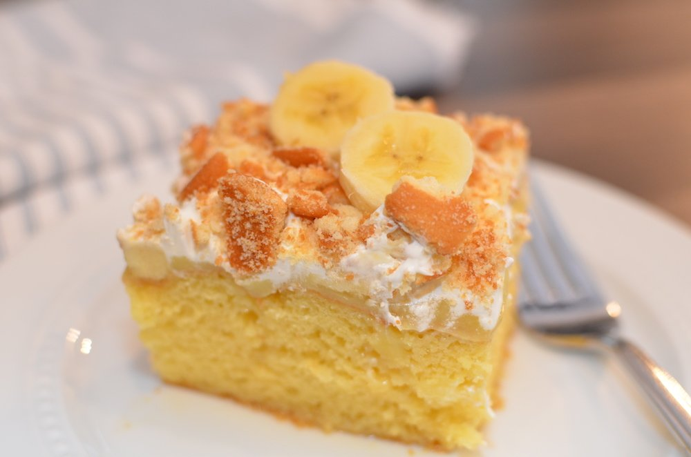 Piece of banana pudding poke cake