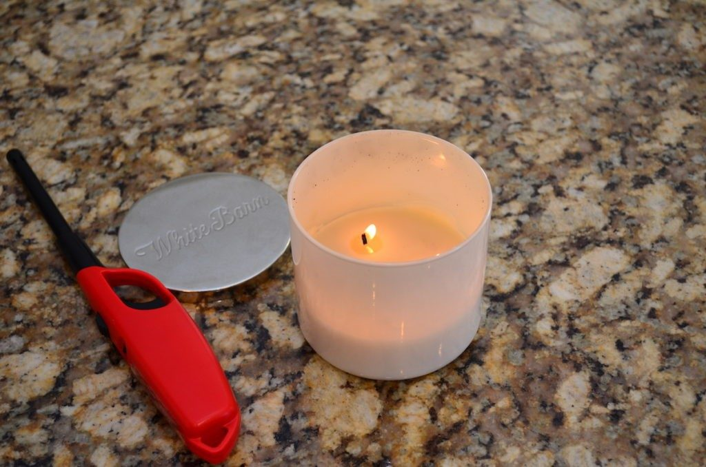 Lit vanilla candle on the kitchen counter