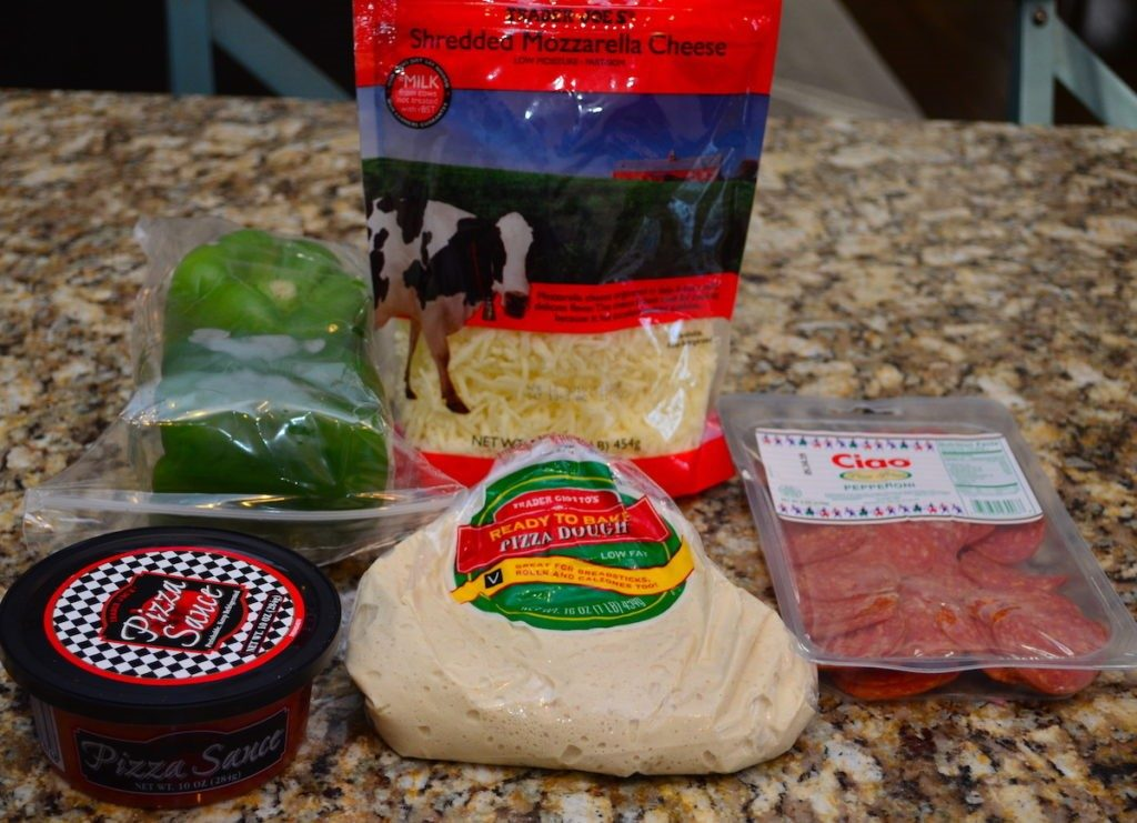 Trader Joe's Pizza Ingredients including sauce, dough, shredded cheese, pepperoni, and green peppers.