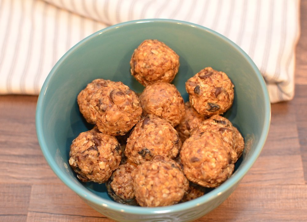 Peanut butter protein bites in a small bowl