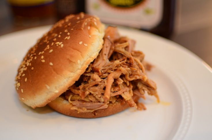 Pulled pork on a sesame seed bun
