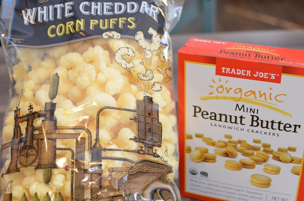 Trader Joe's white cheddar corn puffs and a box of peanut butter crackers including in favorites from Trader Joe's