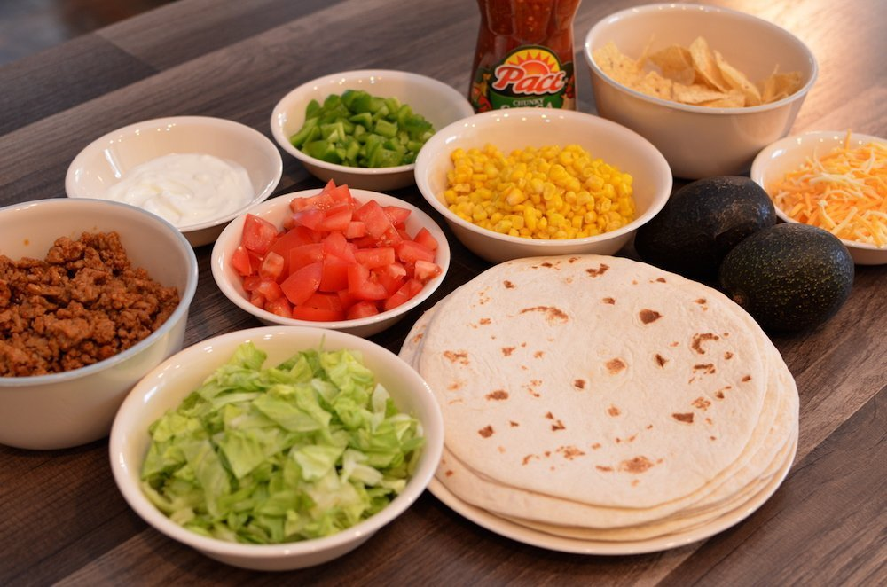 Taco Meat, Vegetables, Tortillas, Cheese, and Salsa for Build Your Own Taco Bar
