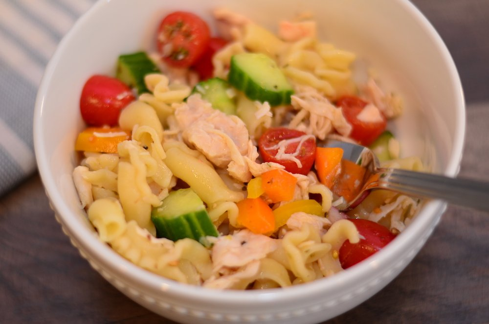 Chicken and vegetable pasta salad in a small bowl